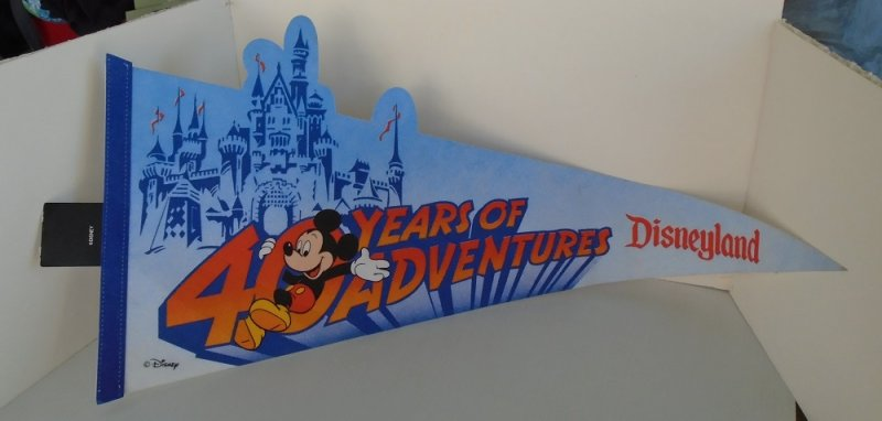 Disneyland 40 Years of Adventure pennant banner flag. 40th anniversary should date it to 1994. 27.5 inches long. Felt. Store tag still attached.