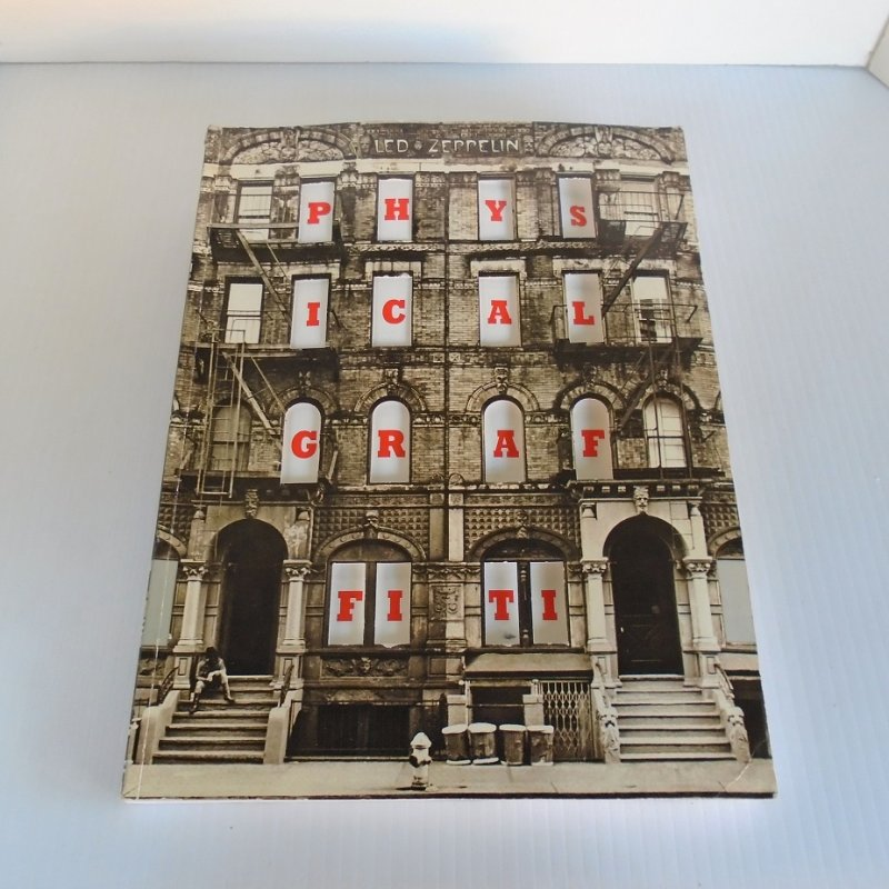 Songbook containing 251 pages with sheet music and lyrics for 15 Led Zeppelin Physical Graffiti recordings. Excellent condition and very clean.
