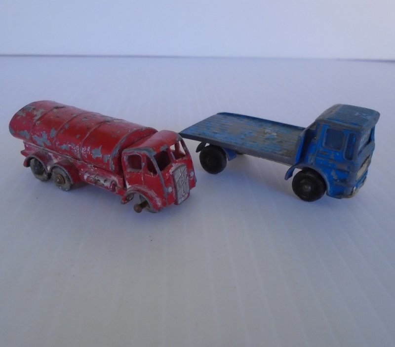 Two 1960s vehicles from Lesney Matchbox. Petrol Tanker number 11 and Site Hut Truck number 60. Old and well played with.