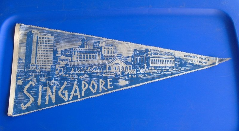 Vintage 1950s to 1960s Clifford Pier & Sea Front Singapore pennant banner. 24 inches long, blue and white in color. Estate purchase.