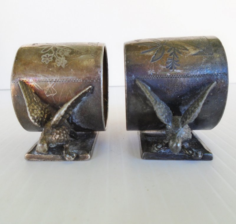 Antique silver plated set of 2 napkin holders. Marked Meriden and has the number 146. Great patina. Estimated to be from between 1850s to 1890s.