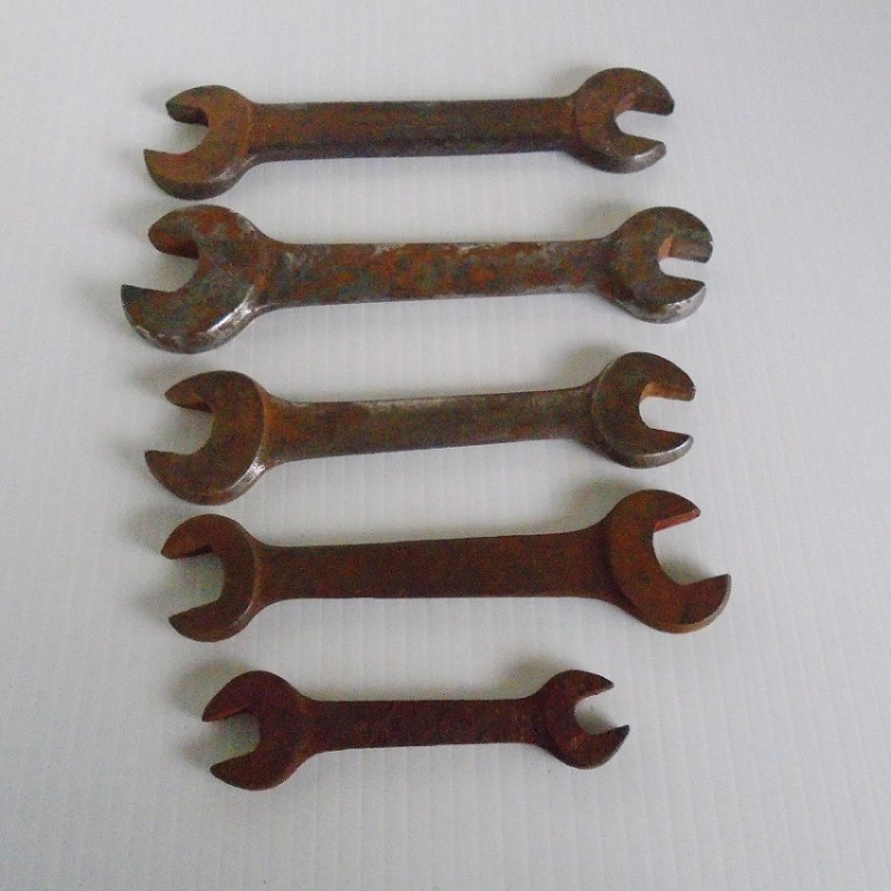 Very old, possibly 1930s open end wrenches. Total of 5. One marked Fairmont, one marked Billings, 3 not marked or unable to read. Estate find.