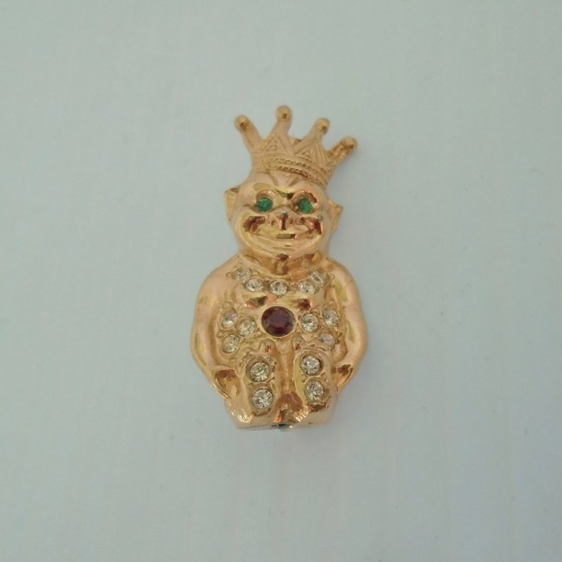 Billiken brooch measuring 1.5 inches tall.  Billiken is the mascot of the Royal Order of Jesters, a Shriner group of Freemasonry. A good luck symbol.