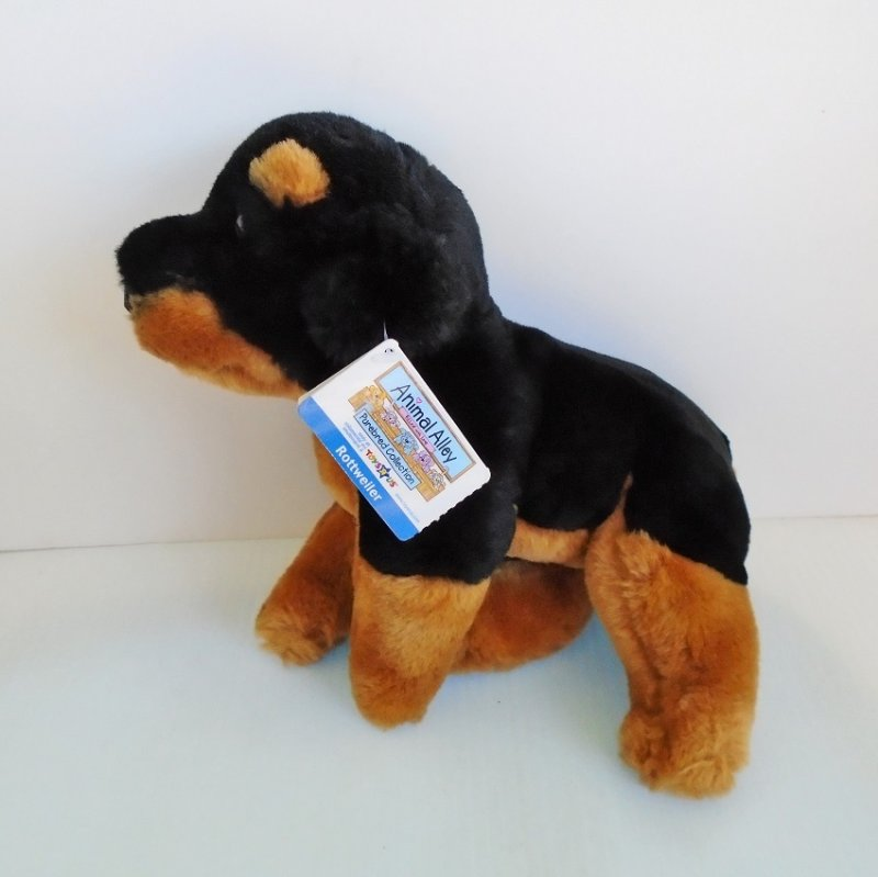 Purebred plush Rottweiler about 12 inches tall made by Animal Alley and offered exclusively by Toys-R-Us. Dates to around the year 2000.