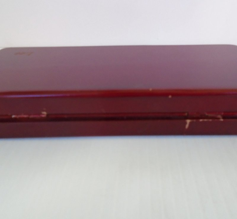 Vintage 1960s desk set consisting of a pen and letter opener, silver in color. Housed in a cherry wood box. Complete set is in excellent condition.