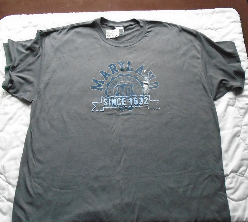 Souvenir t-shirt from the Baltimore Maryland airport. Size XXXL. New, with all tags attached. Gray in color with blue logo.