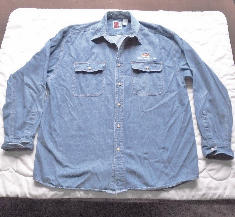 Wells Fargo Bank faded blue button up shirt. Long sleeves. Size XL. Has stagecoach logo on left breast.