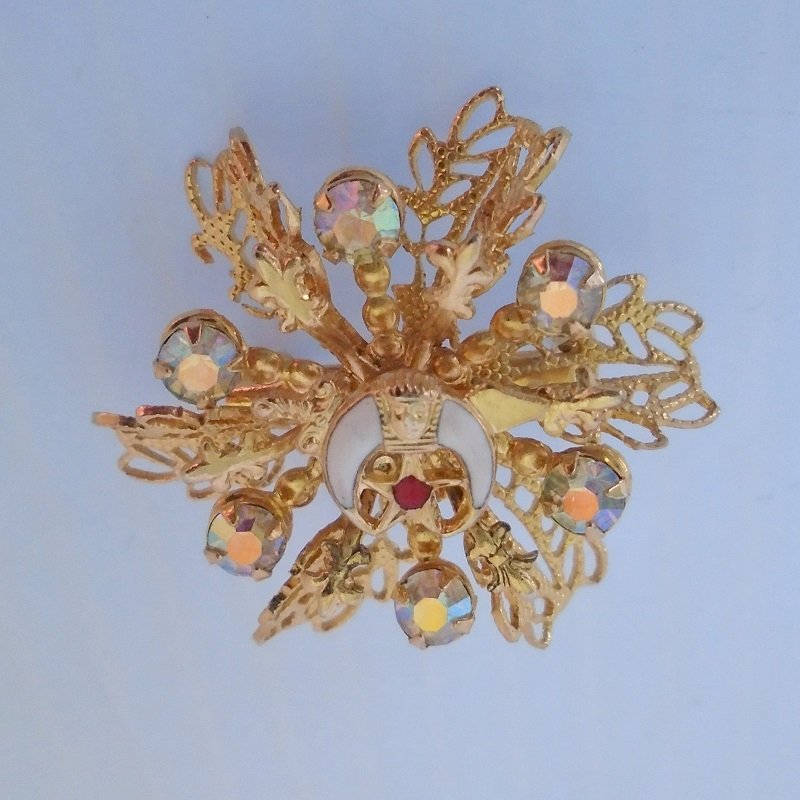 Flower design pin brooch from Masonic Mystic Shriner. 1.25 inch. Tiger claws, Sphinx, Star of Bethlehem surrounded by Aurora Borealis stones.