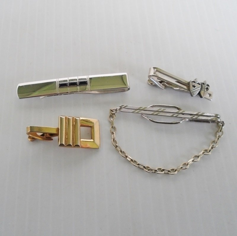 Four vintage tie bars and clips. Signed Anson, Shields, Pioneer, and Hickok. Possibly 1950s to 1960s time frame. Estate purchase.