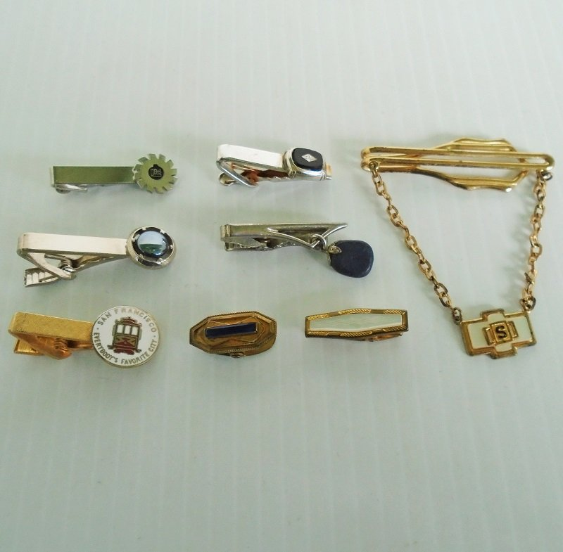 Eight vintage tie bars and clips. No maker's signatures. Probably 1950s to 1960s time frame. Estate purchase.