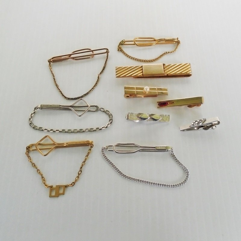 Ten vintage tie bars and clips, all marked SWANK. Two patented 1932, one 10krpg. Others probably 1950s to 1960s time frame. Estate purchase.