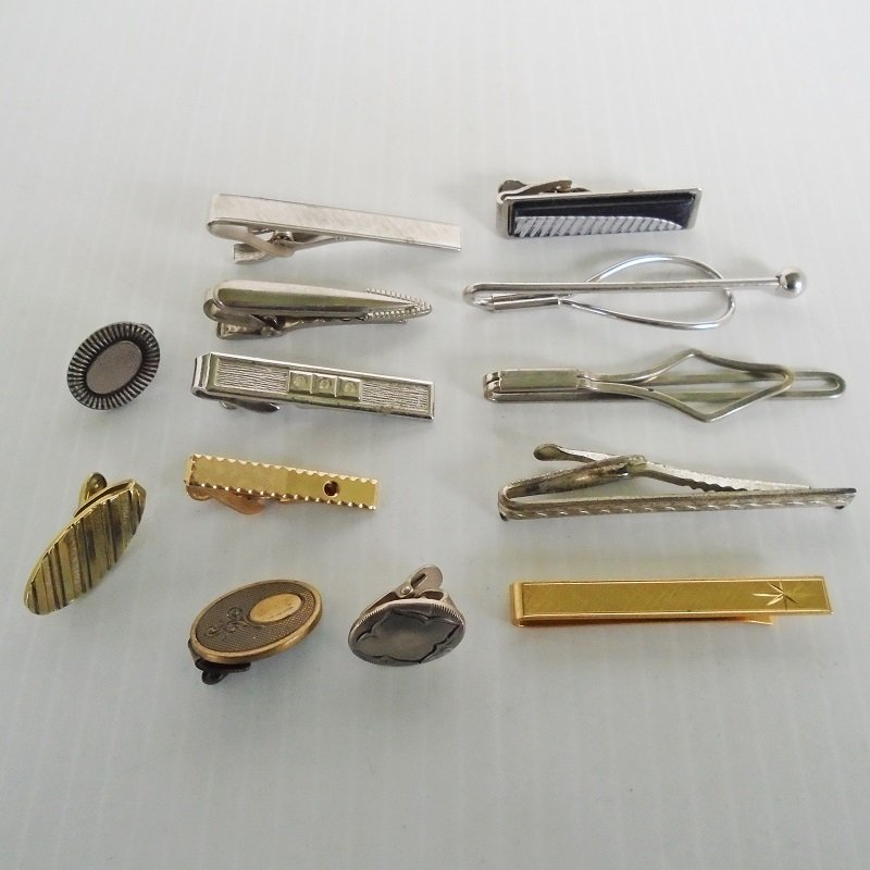 Thirteen vintage tie bars and clips, 1 marked Hickok, 12 unsigned. Possibly 1930s to 1960s time frame. Estate purchase.