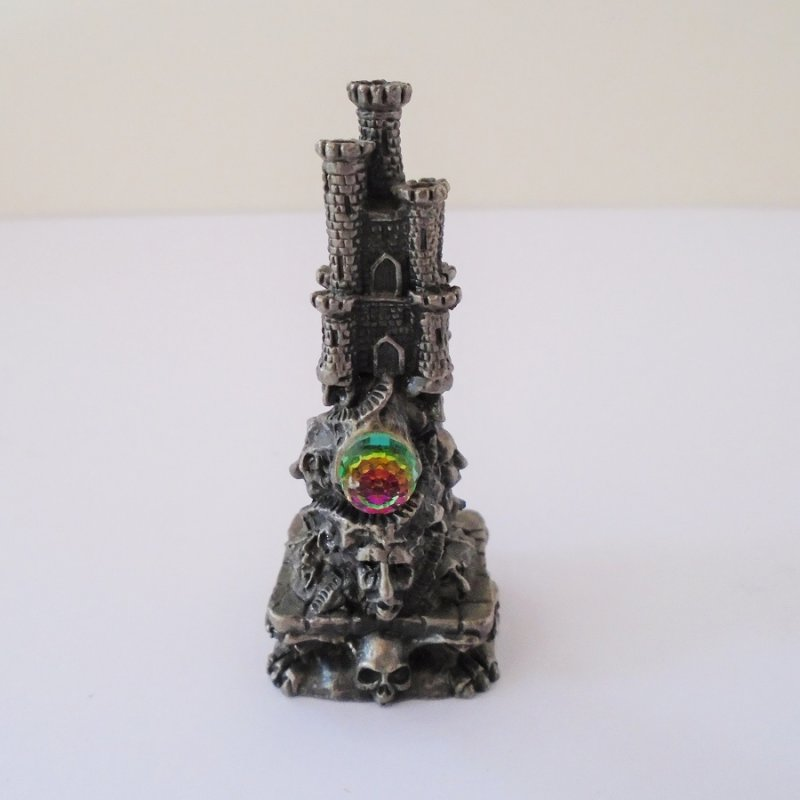 Front view Gorham Magic Crystal Chess. Doom Castle. Complete with Swarovski faceted crystal ball. 2.75 inches tall. Skulls on base. Estate find.