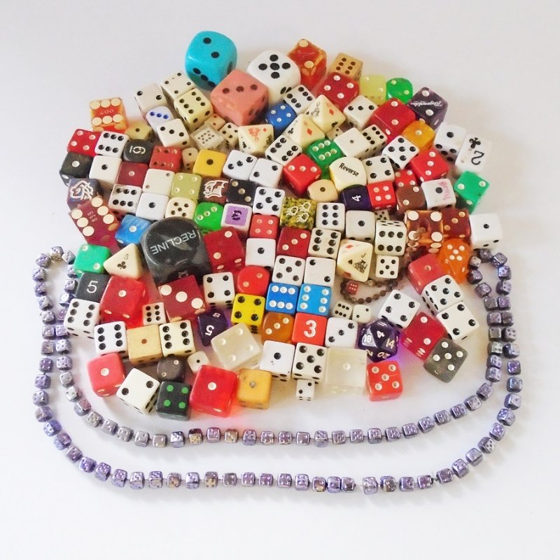 Individual die or dice. 131 pieces plus a dice necklace. Various sizes, shapes, and colors. All used. Unknown dates, estate find.