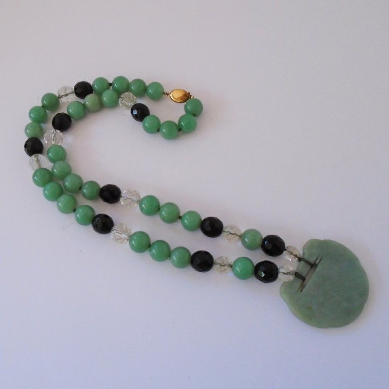 Jade necklace, 24.5 inches. Jade and misc beads with a large etched disk as it's centerpiece. Estimated 1960s. Estate find.