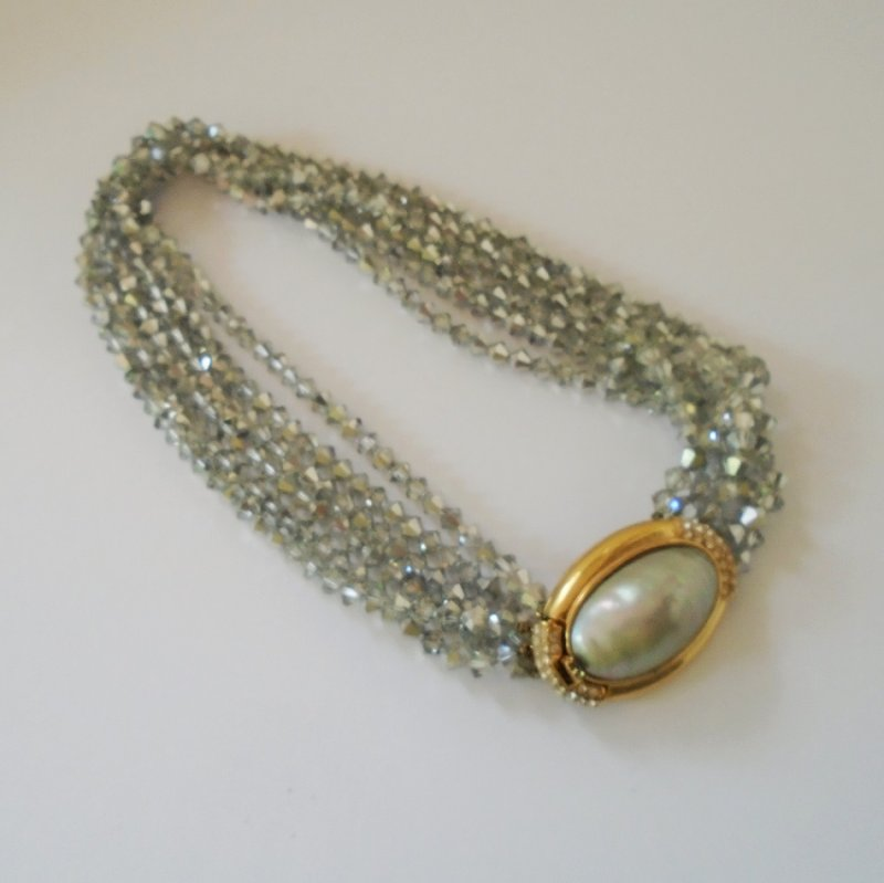 Ciner faux pearl centerpiece capped with rhinestones. Choker necklace measures 17.5 inches. Estimated 1960s. Estate find.