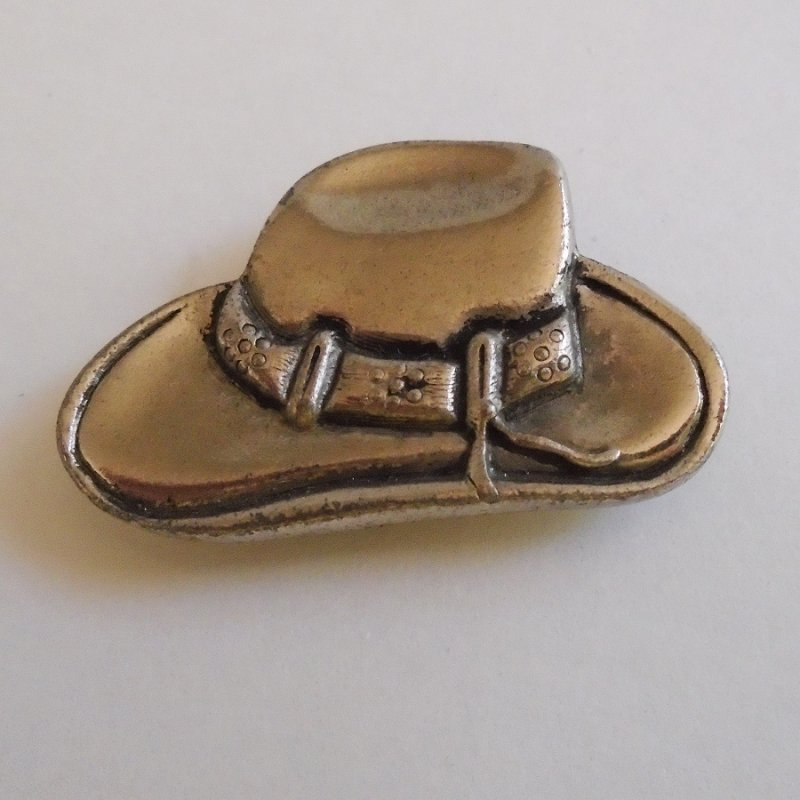 Silvertone Cowboy Hat Button Cover marked 'NONY New York'. Fits most standard sized buttons. Classy looking. Estate find.