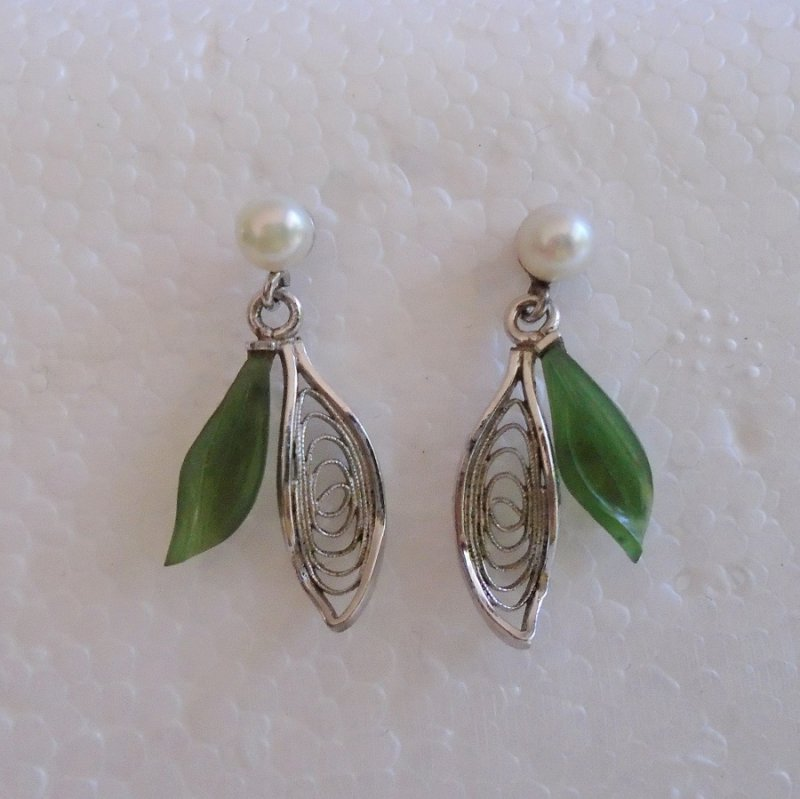 Pierced earrings, circa 1964, never worn. Marked 'Sterling' and 'Wells'. Chrysoprase leaf topped with a pearl. 1 inch.
