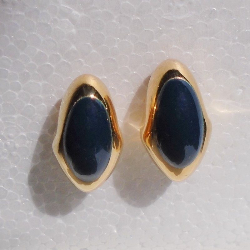 Pierced earrings, goldtone with deep royal blue stones. 3/4 by 3/8th inches. Unknown age, estate sale purchase.