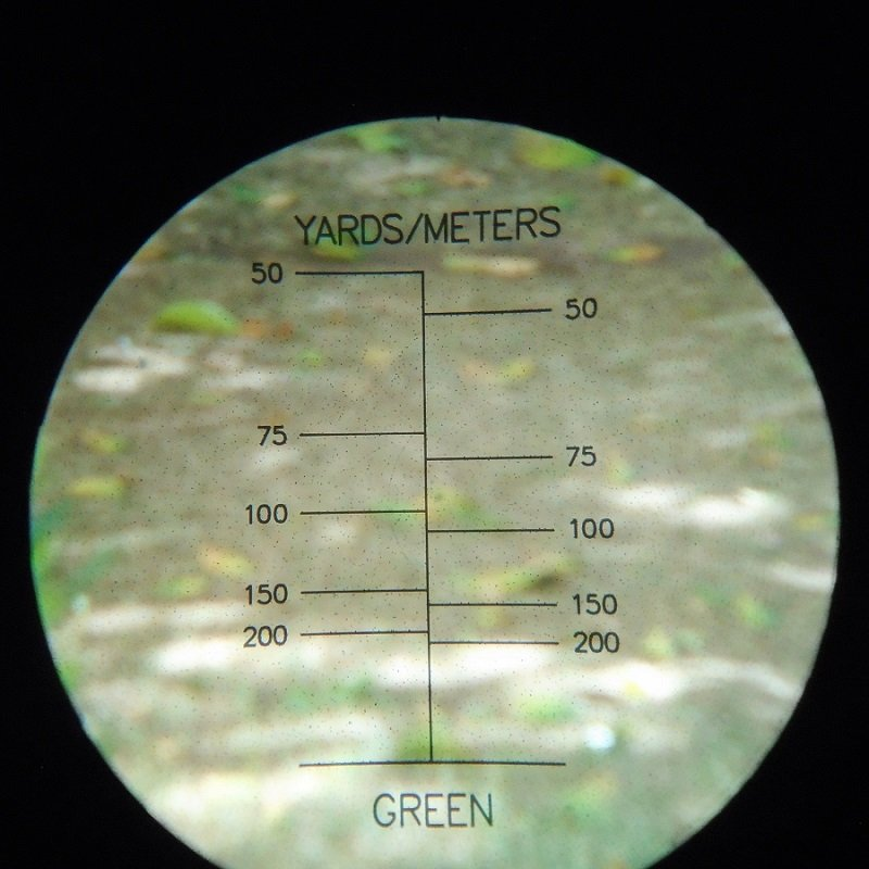 Sharper Image distance gauge golf scope. 10x25mm. Etched lens that reads up to 200 yards. Lightweight pocket size. Estate find.
