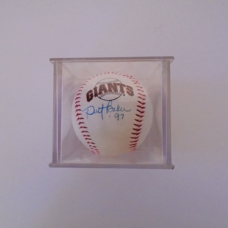 Dusty Baker 1997 signed baseball with the San Francisco Giants logo. In protective acrylic display case. Estate find.