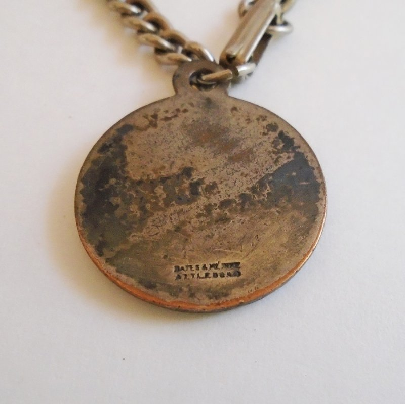 Back of very old Knott's Berry Farm pendant charm. Features a Conestoga wagon. Estimated to be 1940s thru 1950s. Estate purchase.