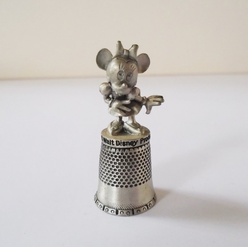 Souvenir pewter thimble featuring Minnie Mouse. From Walt Disney Products. Dated 1979.  Estate find.