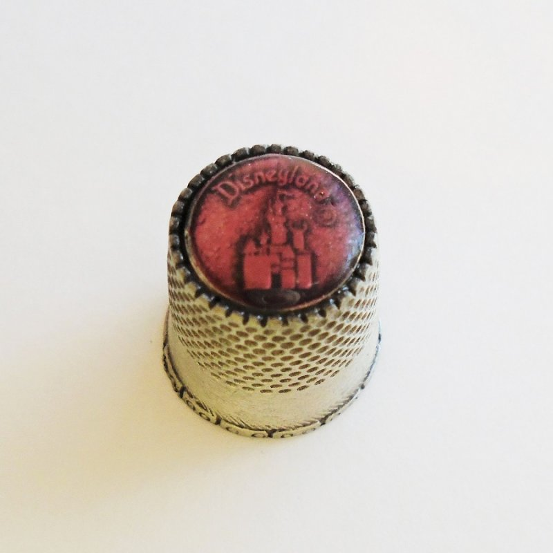 Souvenir pewter thimble featuring Sleeping Beauty's Castle. Rose pink top. From Walt Disney Productions. Pre 1986.  Estate find.