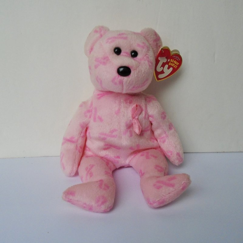 TY Breast Cancer Awareness pink beanie baby. 9 inches tall. Pink in color. Has pink ribbon on left breast. Handmade. Has ear and tush tags.