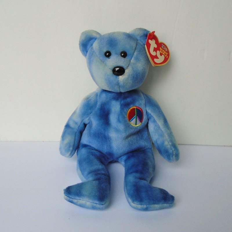 TY blue marbled peace sign bear. 9 inches tall. Has embroidered peace sign on left breast. Birthday of November 17, 2002. Has ear and tush tags.