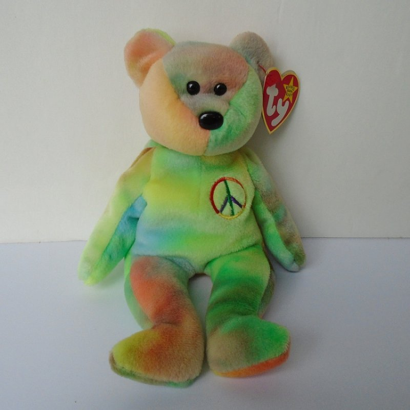 TY pastel peace sign bear. 9 inches tall. Has embroidered peace sign on left breast. Birthday of February 1, 1996. Has ear and tush tags.