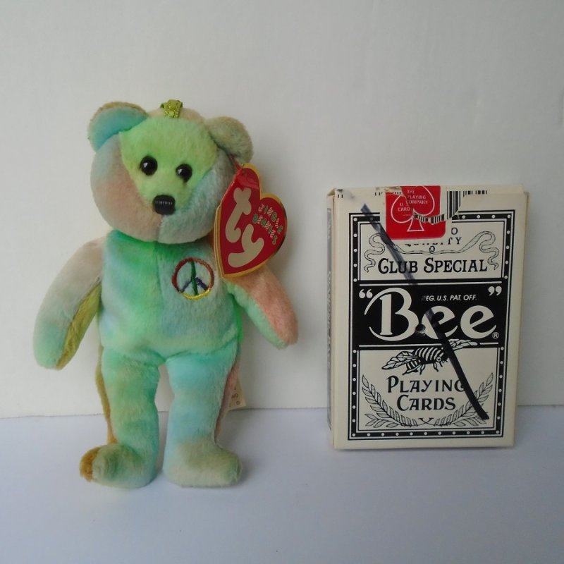 TY Jingle Beanie Peace sign bear. Also serves as an ornament or can be hung wherever desired. 2001. Pastel coloring. 5 inches tall.