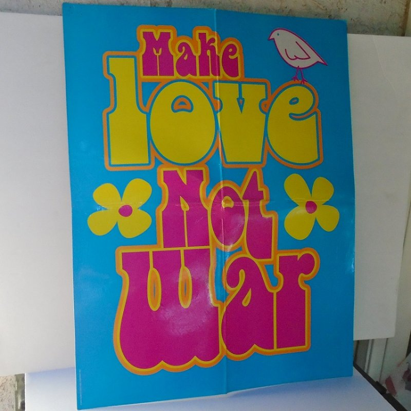 Hippie type peace sign poster, probably in protest of Vietnam War stating