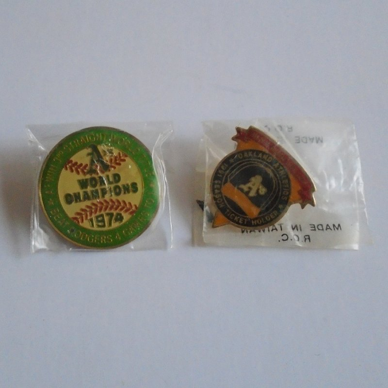 Two Oakland A's Athletics World Series Pins. Both commemorating their 3rd straight world championships from 1988, 1989, and 1990.