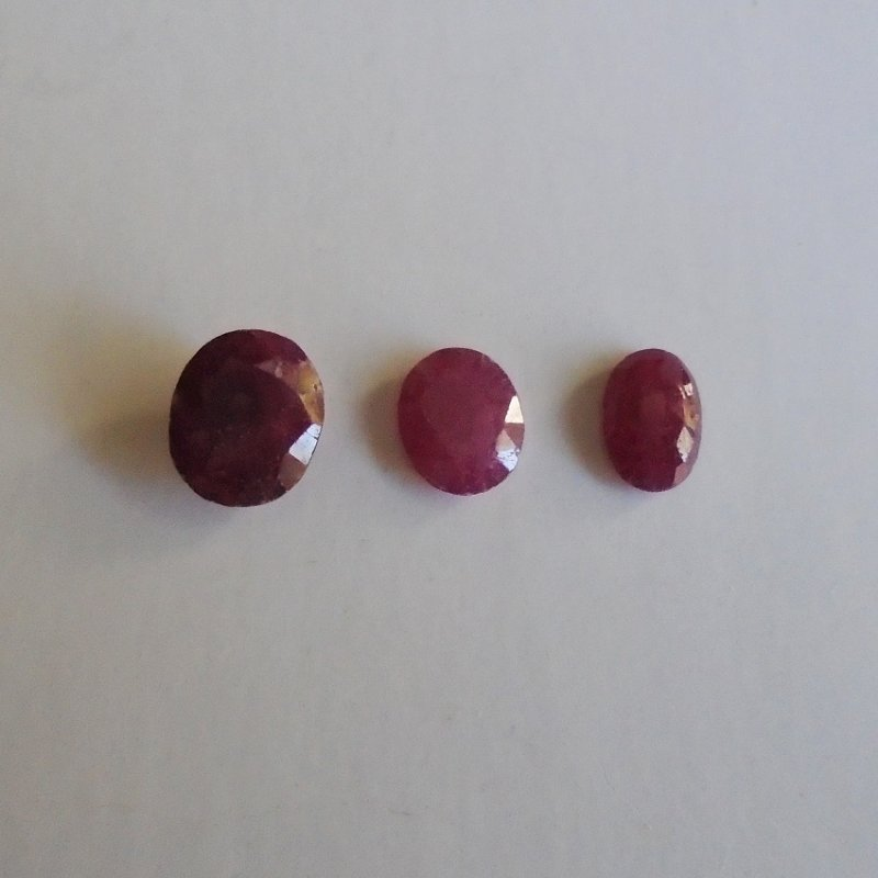 3 Ruby gemstones, .6 grams total weight for all 3. 8mm x 6mm x 3mm, 7mm x 5mm x 2mm, 7mm x 5mm x 1.5mm.
