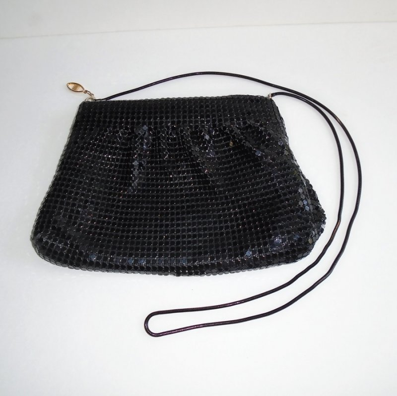 Sequined evening shoulder bag, black in color. Measures approx. 6.5 by 10 inches. Estimated time frame is 1960s to 1970s. Estate find.