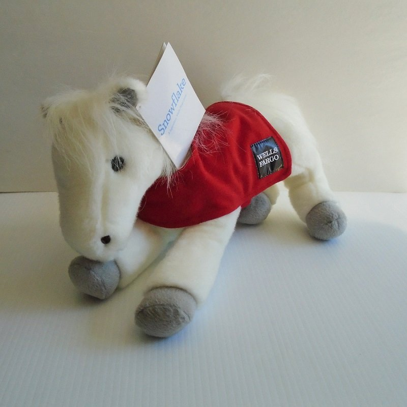 Wells Fargo Bank Legendary Plush Horse Snowflake. Fashioned from the actual work horse from New York City 1910s. Dated 2011 on tush tag.