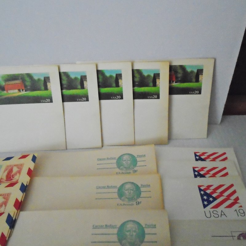 Quantity of 64 antique and vintage unused postcards. Denominations of one cent to twenty cent, 1901 to 1991. Estate purchase.