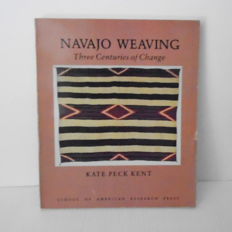History of Navajo weaving for three centuries. This is American Indian art at it's best. First edition book by Kate Peck Kent, many photos throughout.