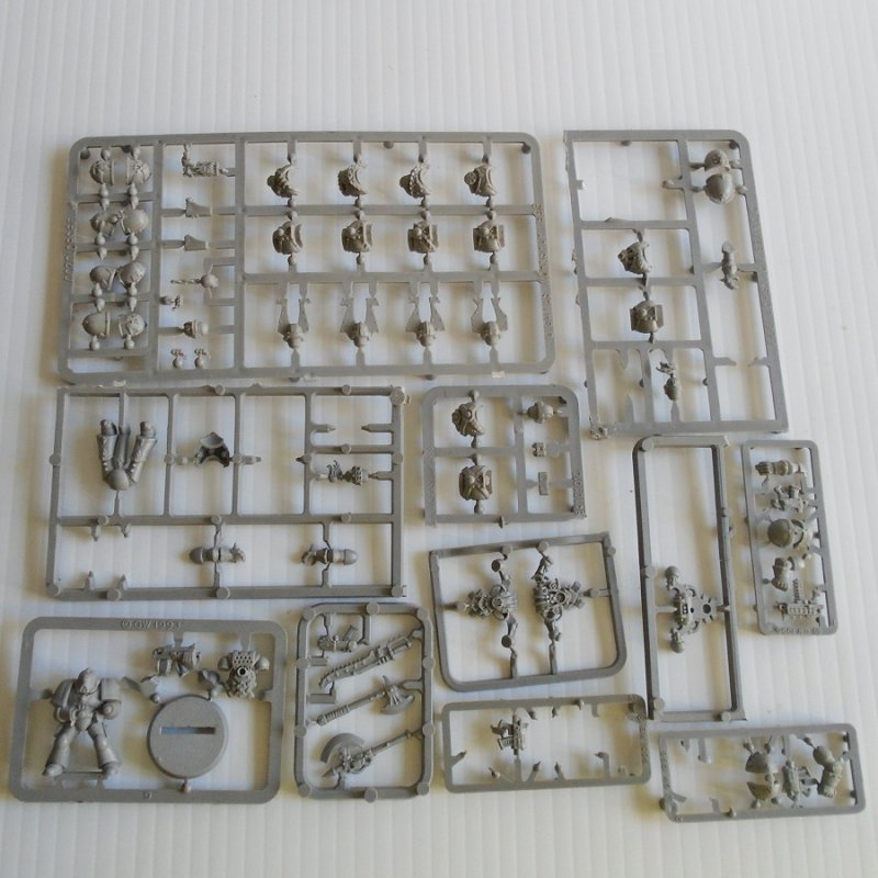 Various parts (weapons, body parts, head gear, and others for Warhammer, Dungeons and Dragons, Mage Knight, or other games. All on sprues. Lot 2