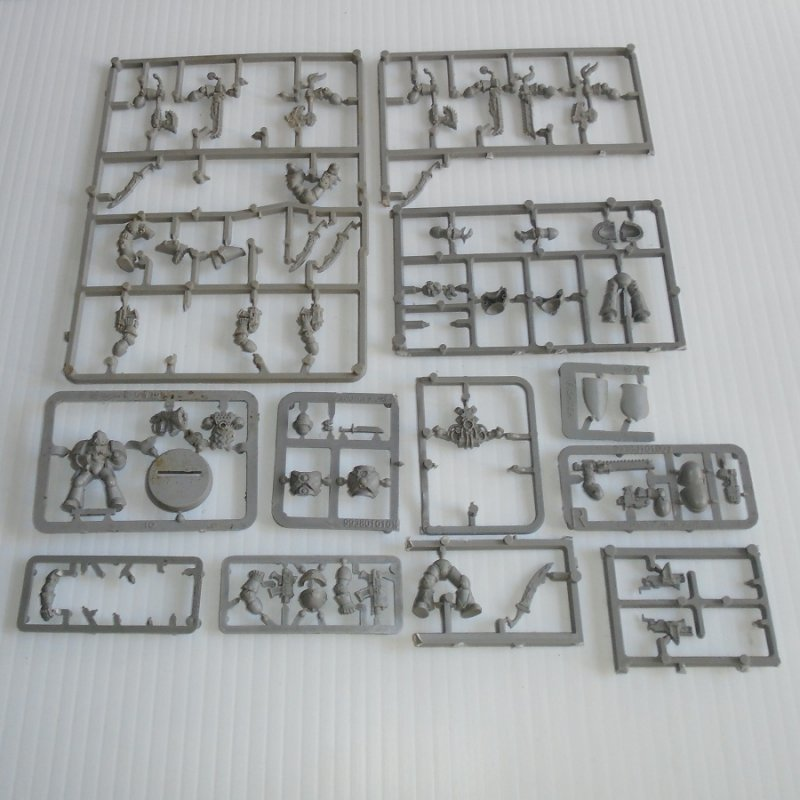 Various parts such as weapons, body parts, head gear, and others for the Warhammer game. Still attached to sprues and frames and never used. Lot 1