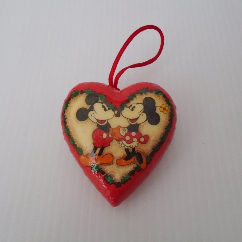 Vintage Mickey Mouse and Minnie Mouse heart shaped Christmas ornament. Purchased at Disneyland. 3 inches.