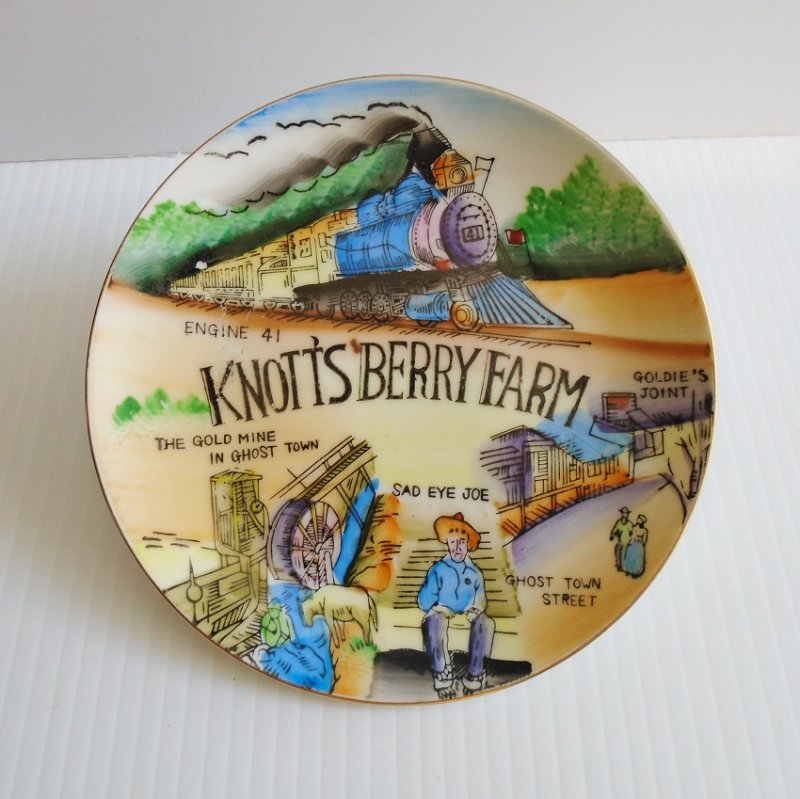 Knott's Berry Farm and Ghost Town vintage wall plate. Features the Gold Mine, Ghost Town, Sad Eye Joe, others.  Estate purchase.