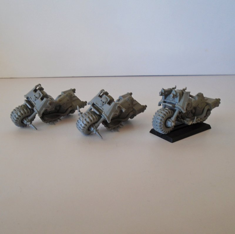 Motorcycle bikes for use in the game of Warhammer. 3 pieces. They are plastic and gray in color. Estate purchase.