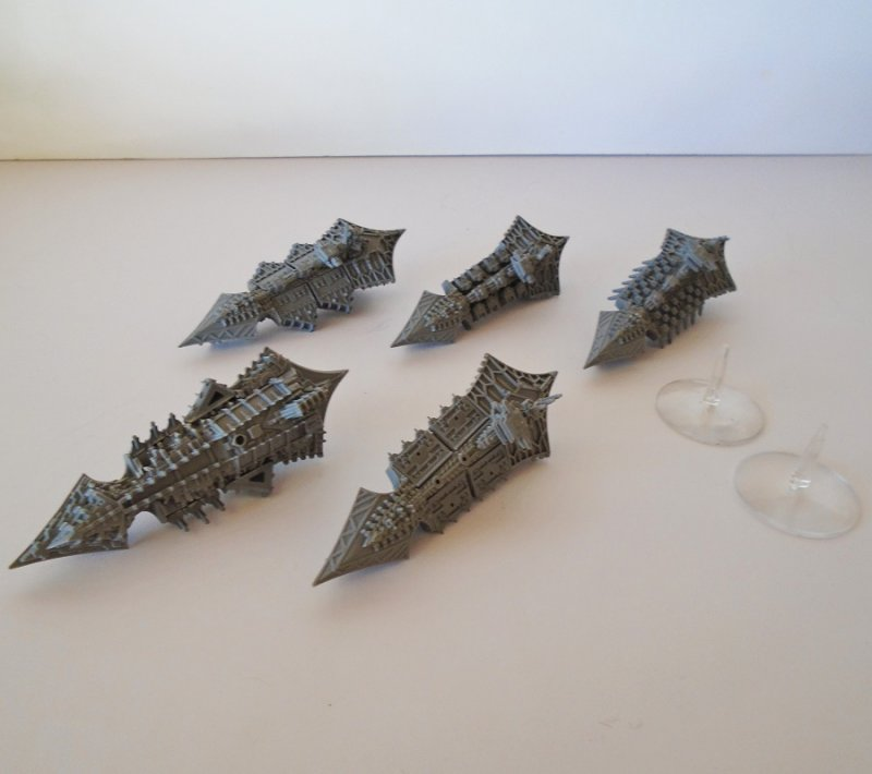 Quantity of 5 spaceship type figurines for use in the game of Warhammer. They are plastic and gray in color. Estate purchase.