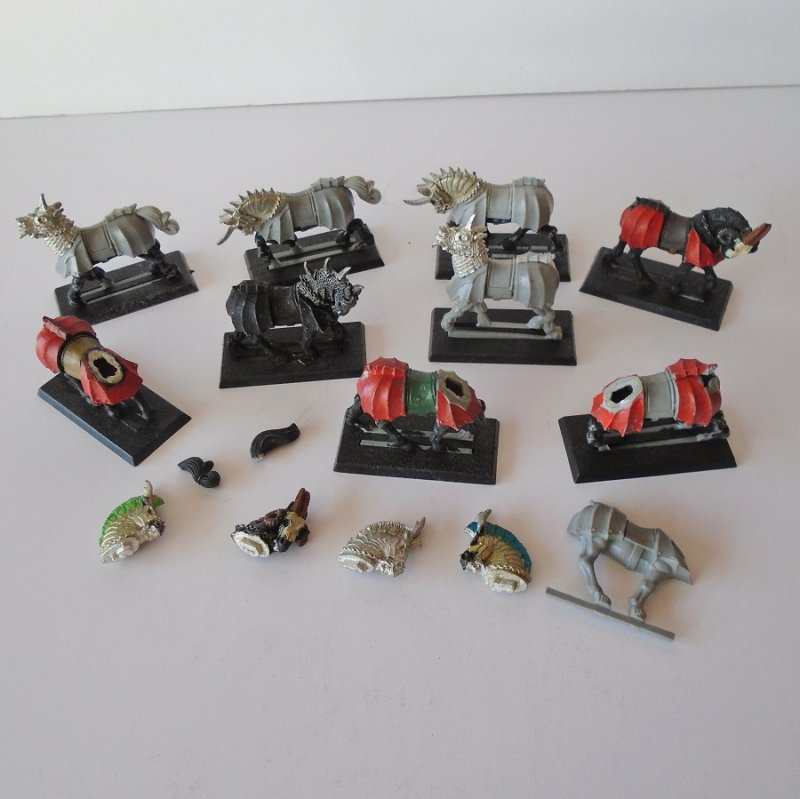 Quantity of 9 horses for use with the Warhammer game. Horses have different accessories added and may or may not be complete.