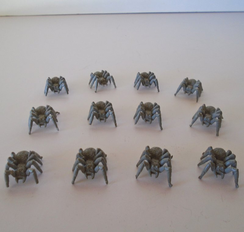 Quantity of 12 spiders for use with the Warhammer game. All are same size of about one inch. All are unpainted plastic.