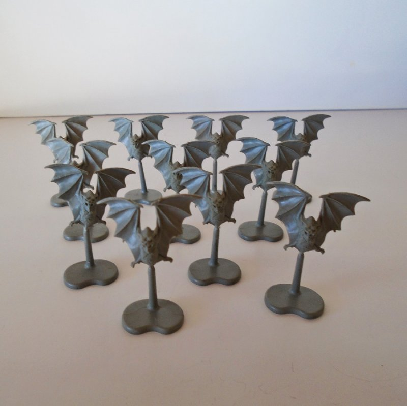 Quantity of 11 flying bats for use with the Warhammer game. All are on stands. All are the same size of 1.75 inches tall. All are unpainted plastic.