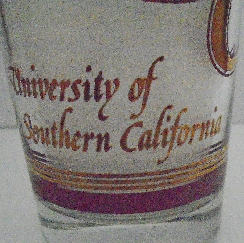 Early 1970s vintage USC University Southern California Vintage Drinking Glass. Features clock tower on Mudd Hall and other logos.