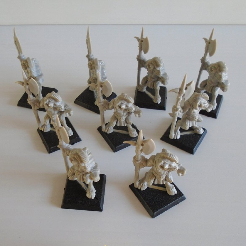 Quantity of 9 fighting figurines holding axes. For either Warhammer, Dungeons and Dragons, or Mage Knight. Unpainted, unused.